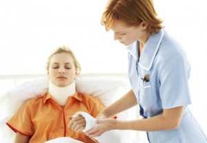 Young Nurse Tending to Young Woman with Neck Brace and Arm Cast